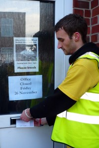 Student Protestor delivers leaflet to Chris Hunes office eastleigh 26 11 10