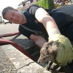 Firefighter Tom Maslin grabs trapped Fox cub