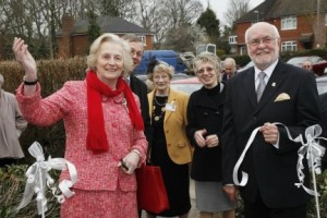 Cllr Graeme Smith assists Dame Mary Fagan as she opens the new pavilion