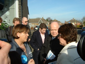 Maria Hutchings and William Hague in conversation with passers by.
