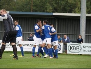 Jai Reason celebrates the opening goal with his team mates (photo by Tony Smith)