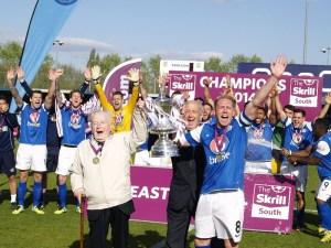 Captain Glen Southam lifts the trophy with club founder Derik Brooks
