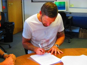 Paul Reid signing on the dotted line