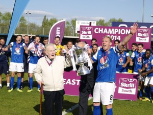 Glen Southam (right) holding the Skrill Sout trophy with club founder Derik Brooks