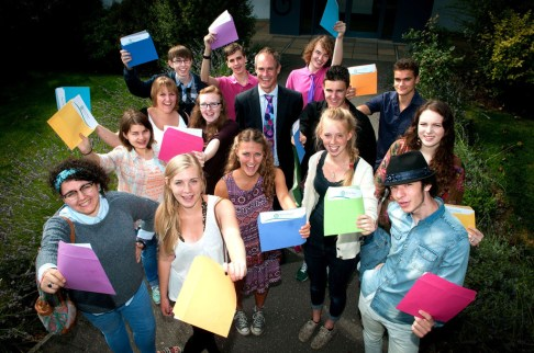 Barton Peveril students celebrating with principal Jonathan Prest