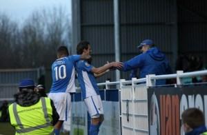 Jack Midson celebrates his brace with team mate Jai Reason (photo by Tony Smith)