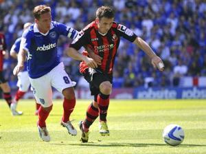 Former Portsmouth captain (left)  signs for Eastleigh