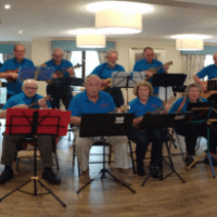 Care home residents entertained by local music society