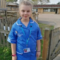 Schoolgirl dresses as Care Worker mum for 'Superhero day'