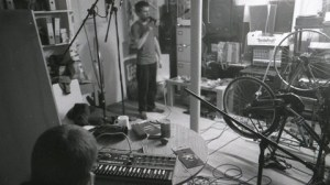 Band members at a recording session.