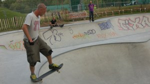 A skateboarder 'drops-in' at Wheel Park