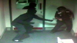 CCTV image of claw-hammer attack on security guard. Pic: Met Police