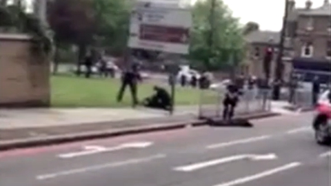 Amateur YouTube footage of armed police officers standing over suspected attackers in aftermath of murder in Woolwich