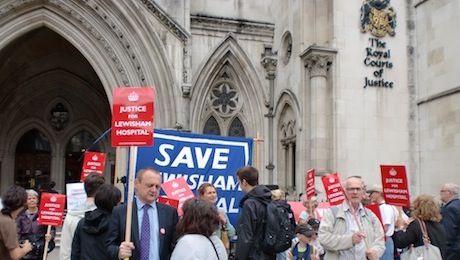 Campaigners gathered outside the Royal Courts of Justice to await the result of the judicial review Photo: Bill Konos