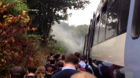 Commuters escape onto the tracks. Pic: BublzMedia/Youtube