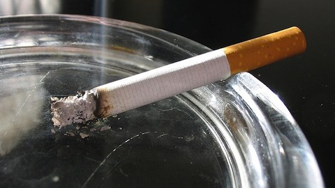 lit cigarette with smoke