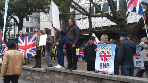 """BNP protesters put up a banner that reads """"Stop all immigration."""" Pic: Courtney Greatrex"""