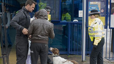 Police stop and search a young man. Pic: Met Police