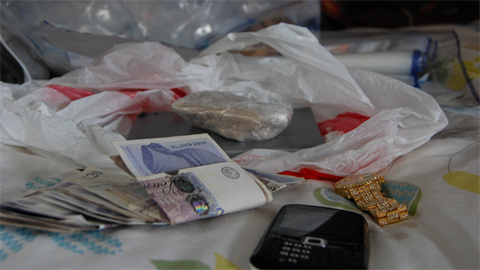 Cash and drugs seized. Pic: Met Police