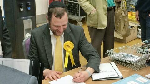 Winning Councillor gleefully signs the deed. Photo: Weidong Lin