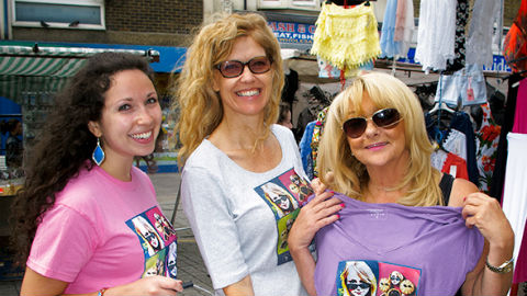 "June Bishop (right), winner of a ""Mince Pies- Eyes"" t-shirt with two volunteers from Whitechapel Mission. Pic: Anne Clements"