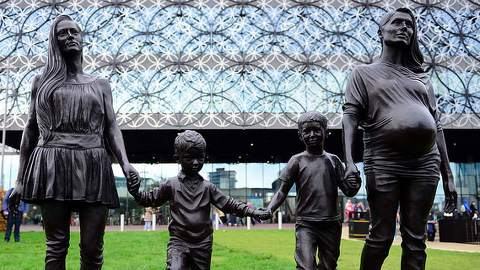 Gillian Wearing's A Real Birmingham Family. The sculpture stands in Centenary Square, outside the new Library of Birmingham.