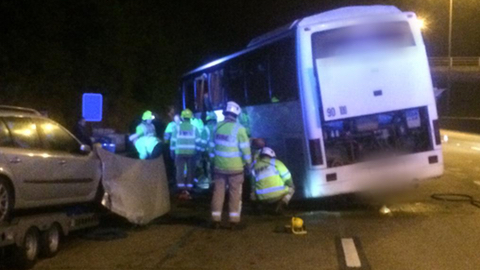 Emergency services at the scene Pic: Surrey Police's Roads Policing Unit
