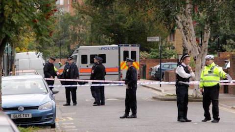 Police on the scene in Clarissa Street, Haggerston. Credit: SWNS