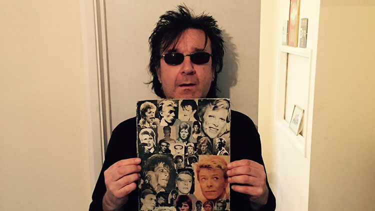 Garry Johnson with Bowie pictures. Pic: Garry Johnson