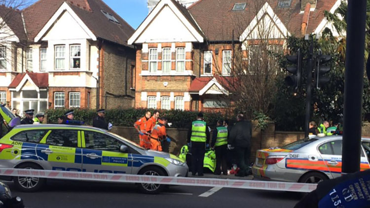 Met Police and First Aid officials on the scene of a moped collision in Hackney. Pic: @999London