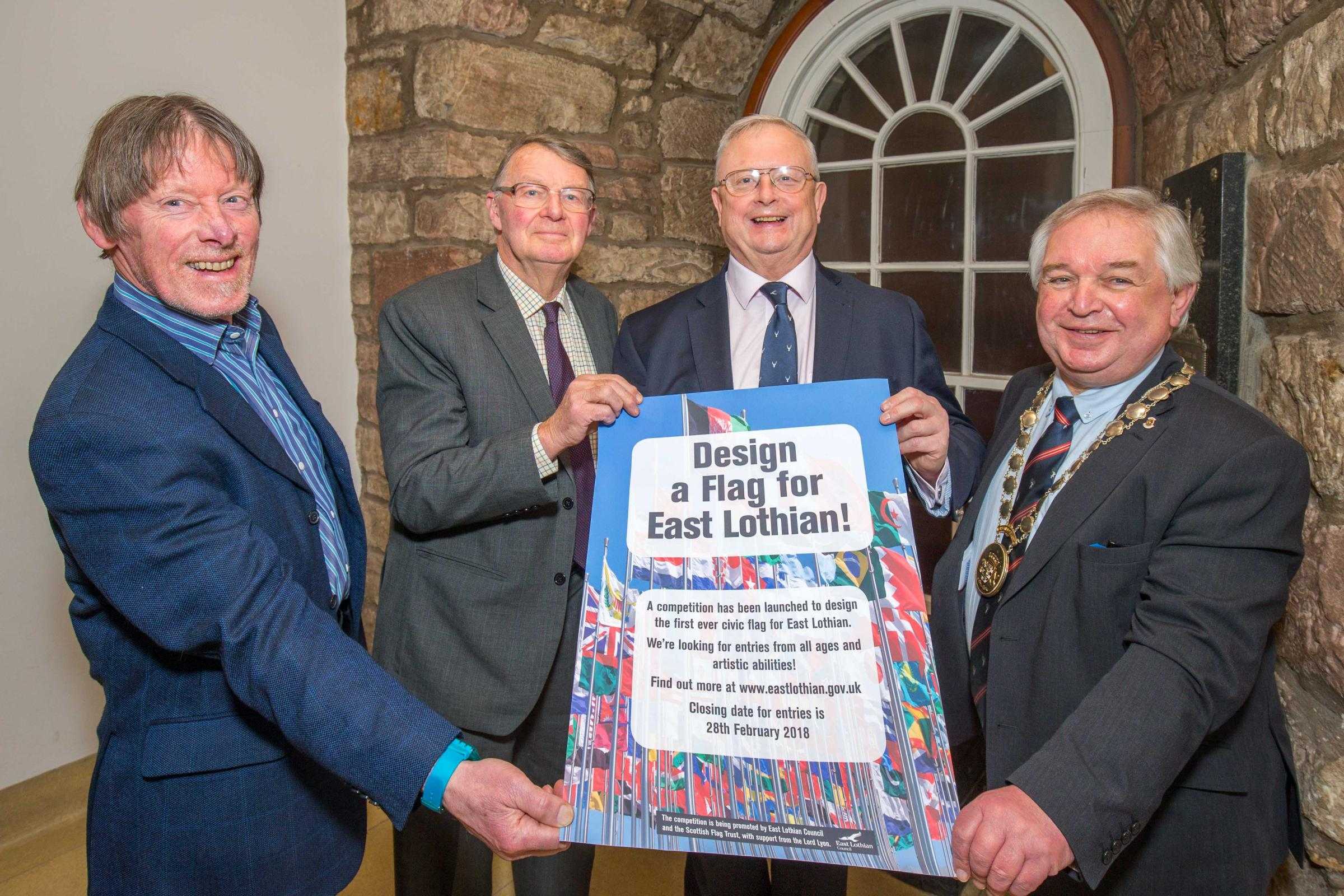 FROM LEFT: Dave Williamson, Scottish Flag Trust; Michael Williams, Lord Lieutenant of East Lothian; Joe Morrow, Lord Lyon; and Provost of East Lothian John McMillan launch the 'Design a flag for East Lothian' competition