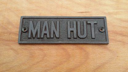 Man Hut Sign