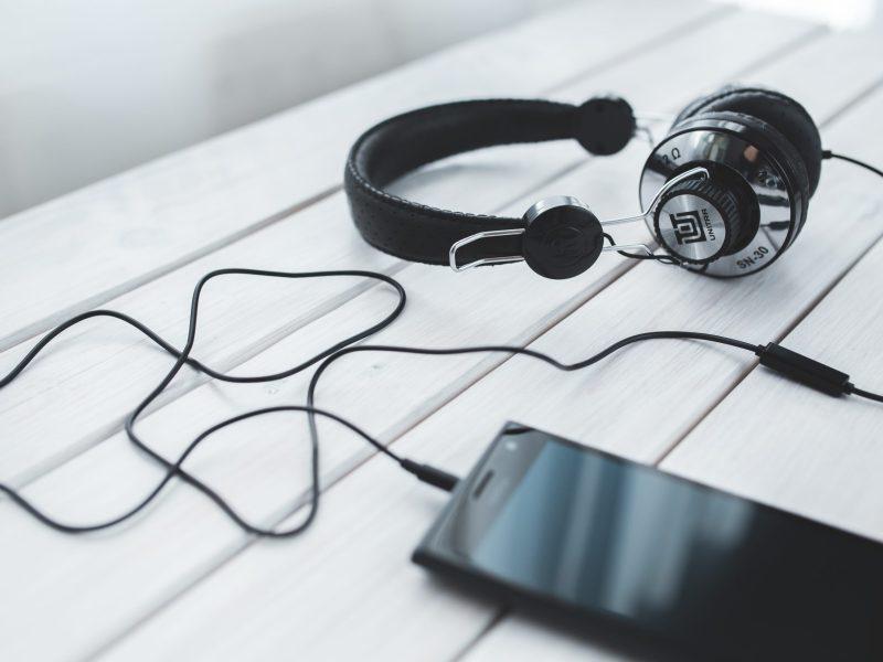 smartphone music technology vintage old gadget black brand font headphones glasses listening audio equipment free time electronic device entertaiment 722528