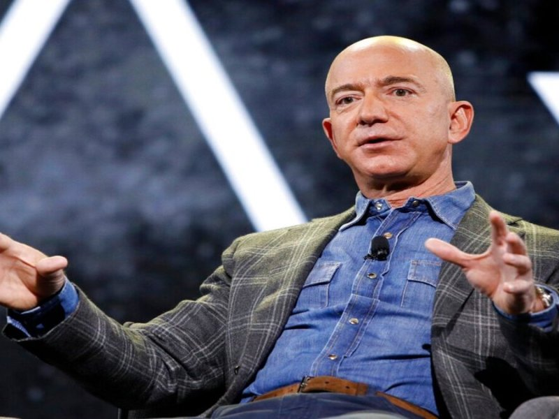 Jeff Bezos riding own rocket on company's 1st flight with people
