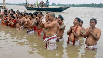 People offer 'tarpan' on Mahalaya as Durga Puja festivities begin