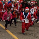YMCA Santa Run fills downtown with holiday red