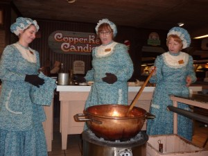 Candy cooks at Silver Dollar City stir the pot, which happens to contain pralines.