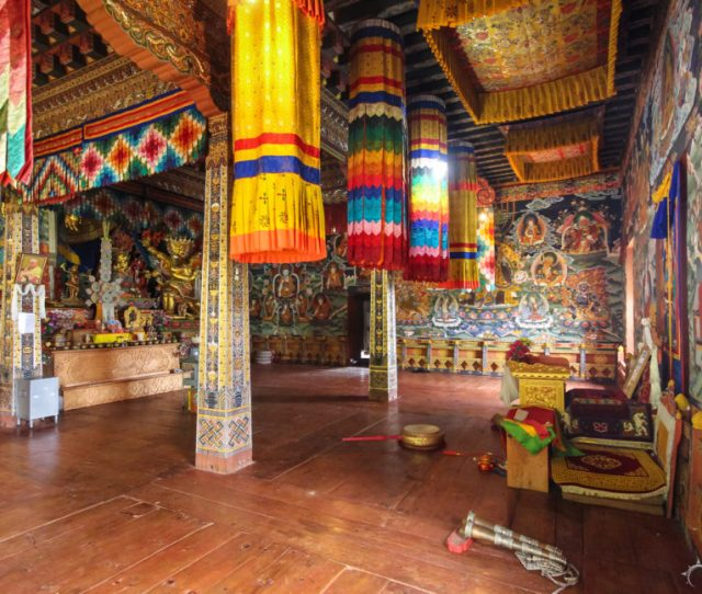 A Colorfully Decorated And Painted With Murals Depicting Buddist Mythology In A Temple Dzong