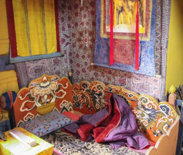 Traditional Bhutanese Colorful Furniture And Wall Decorations Interior In A Palace Of Ogyen Choling