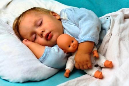 child sleeping with a toy