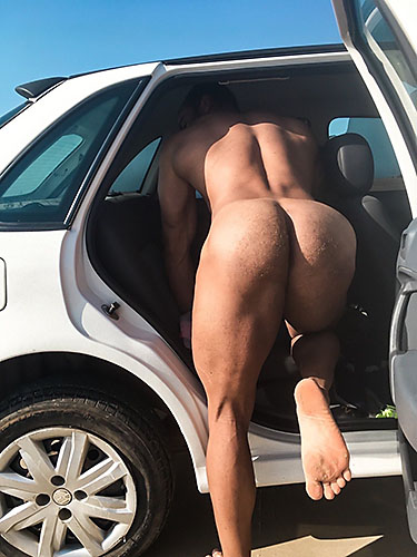 Gay boyfriend showing his hairy ass at the beach, bending over, in his car