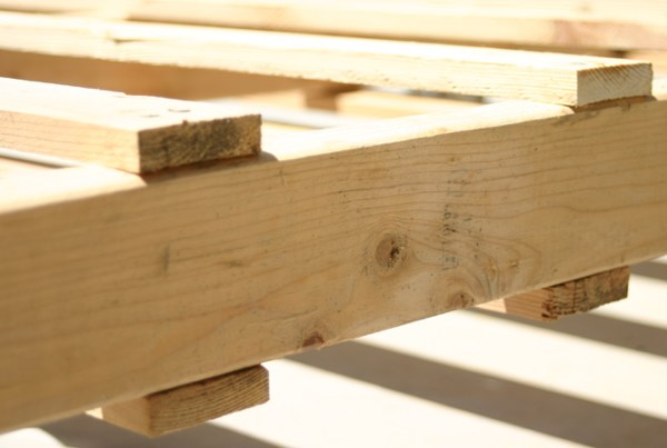 making a bed out of wooden pallets