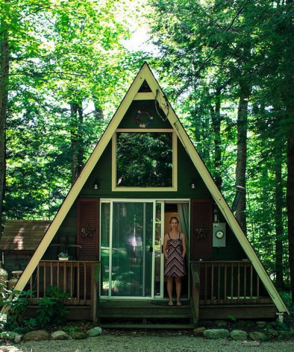 women built her own wood cabin