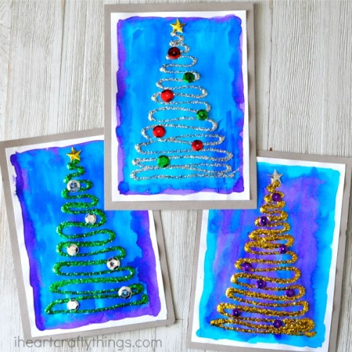 Glittery Christmas Tree Craft via I Heart Crafty Things || One of 10 amazing Christmas crafts kids can make for teachers, grandparents and friends! Super easy and very impressive looking! || Christmas Cards Kids Can Make: 10 More Inspiring Ideas! || Another fun Christmas post from Letters from Santa Holiday Blog