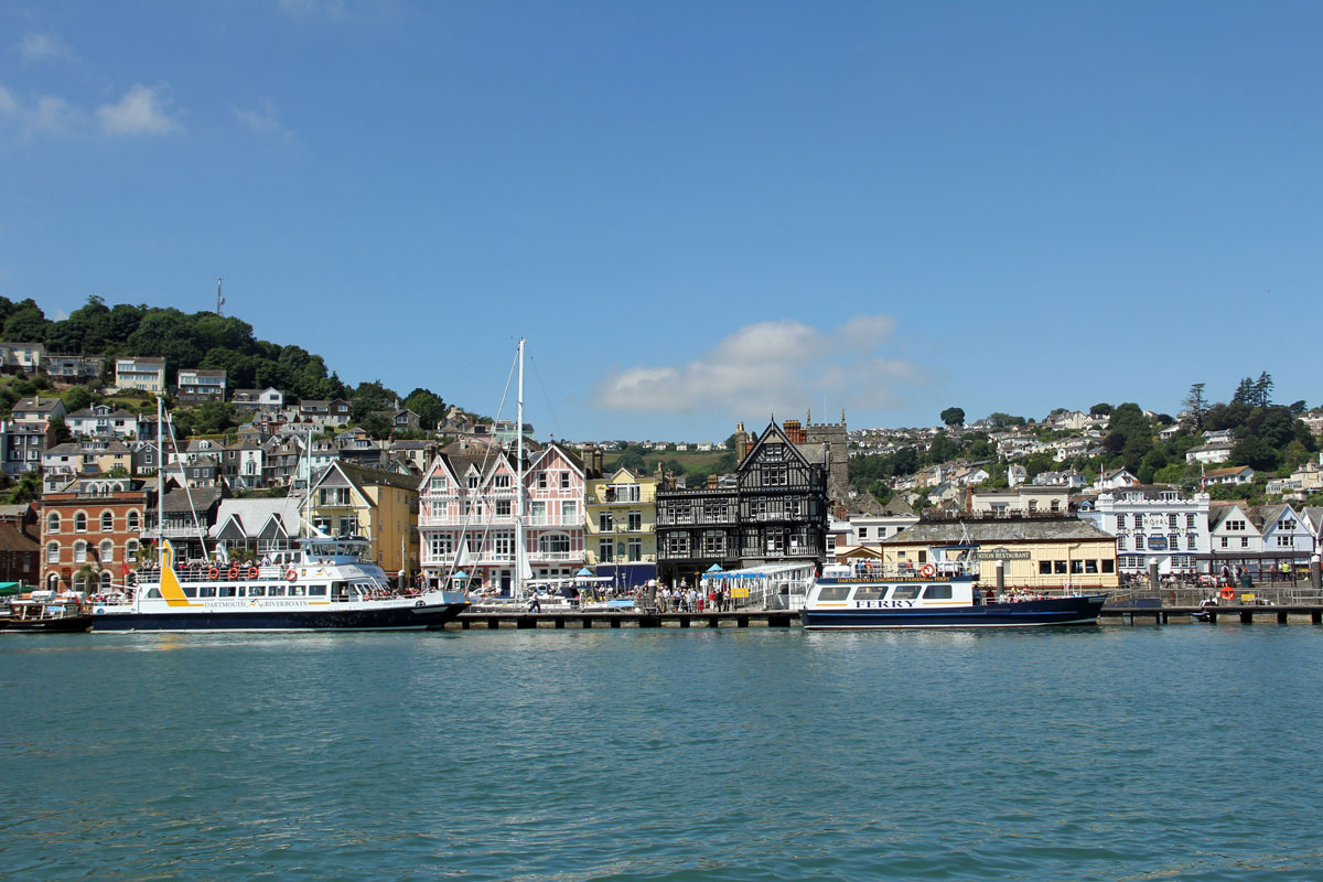 The Kingswear Ferry at Dartmouth next to the former Railway Station (the cream building on the right)