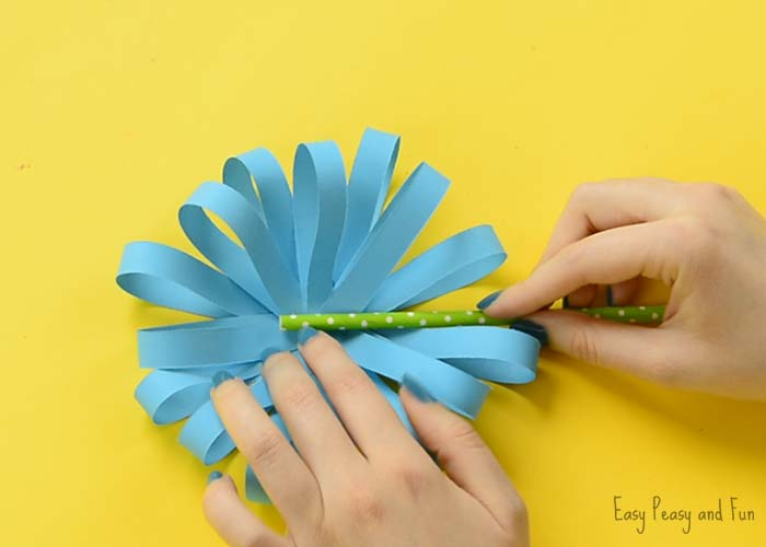 Paper Flower Craft   Easy Peasy and Fun Once you are happy with how full your paper flower craft is looking  apply  some glue onto the green paper straw and press it in the middle of the  flower