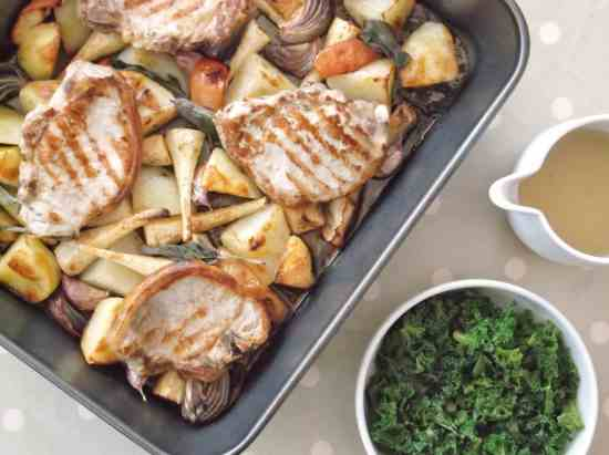 Pork, Parsnip and Apple Traybake - Delicious pork chops cook on top of roast potatoes, parsnips and apple with crispy sage and caramelised onions for a weeknight treat that is ready in under an hour.