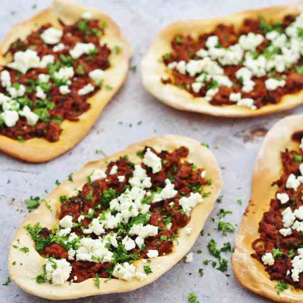 Fancy a twist on the classic Italian style pizza? Why not make these delicious Turkish Spicy Lamb Pizzas! A simple flatbread base topped with spicy lamb mince, herbs and feta cheese and served with a simple middle eastern style salad – so simple, but utterly delicious!