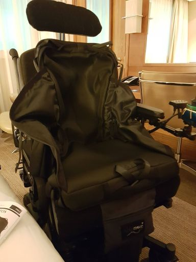 Wheelchair transfers with easyTravelseat, ready for flying on an aircraft as a disabled passenger