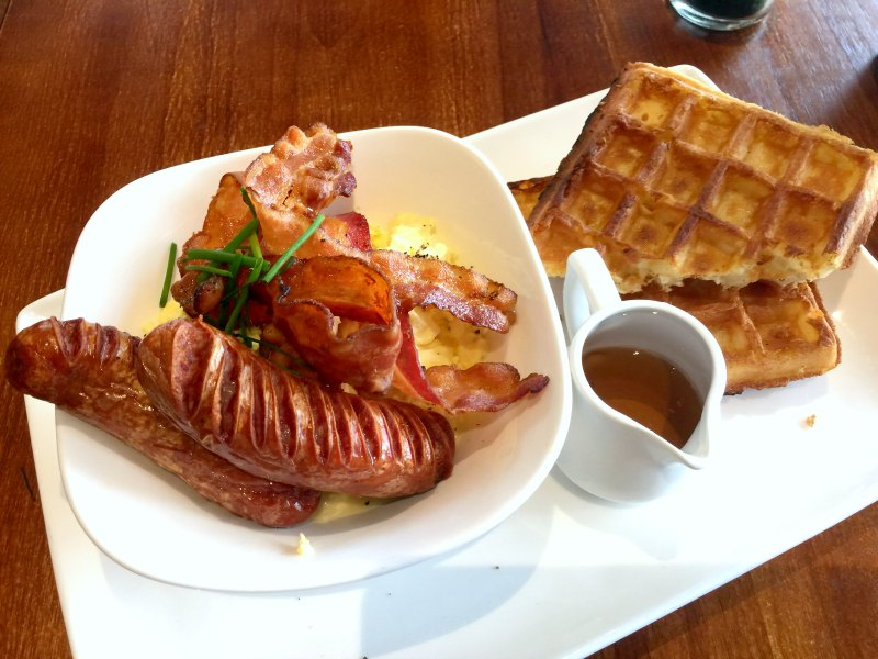 Monniker Scrambled Eggs and Bacon on Waffles with Sausages